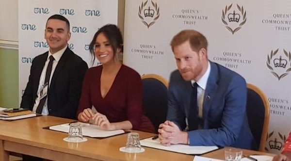 Meghan joins One Young World round table, Harry tags along